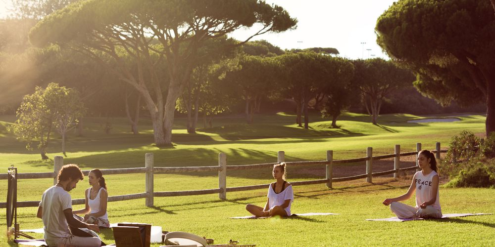 Yoga session in the gardens of Pine Cliffs Resort