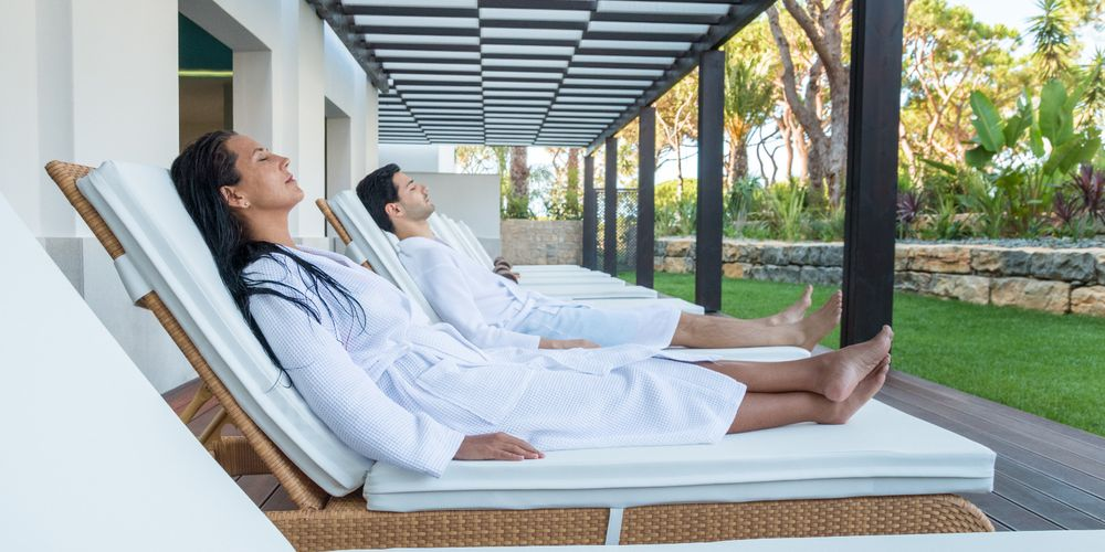Couple in the outdoor lounge at Serenity Spa Algarve